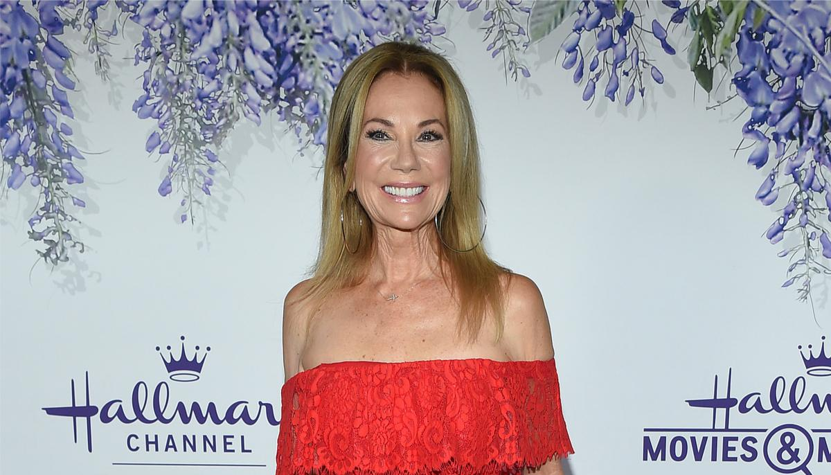 Kathie Lee Gifford standing in front of a Hallmark channel background