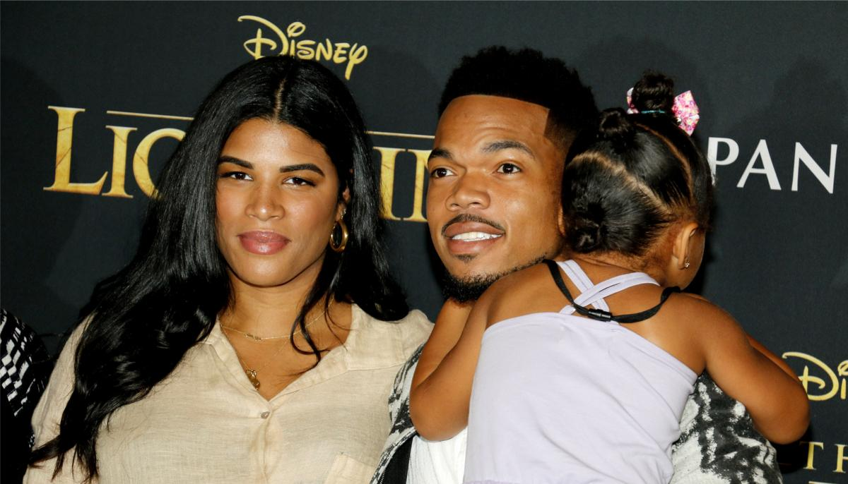 chance the rapper with his wife Kirsten and daughter at a red carpet event