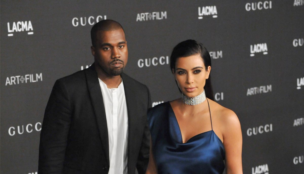 kanye west and wife kim kardashian at a red carpet event
