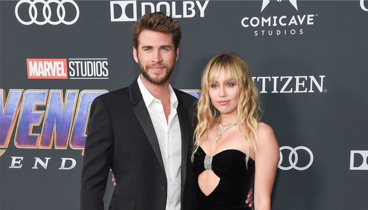 miley cyrus and liam hemsworth at a marvel red carpet event