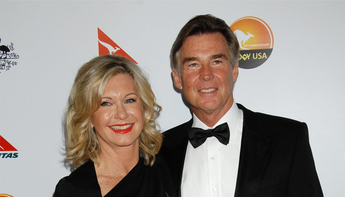 olivia newton john with husband in 2013 at a black tie event