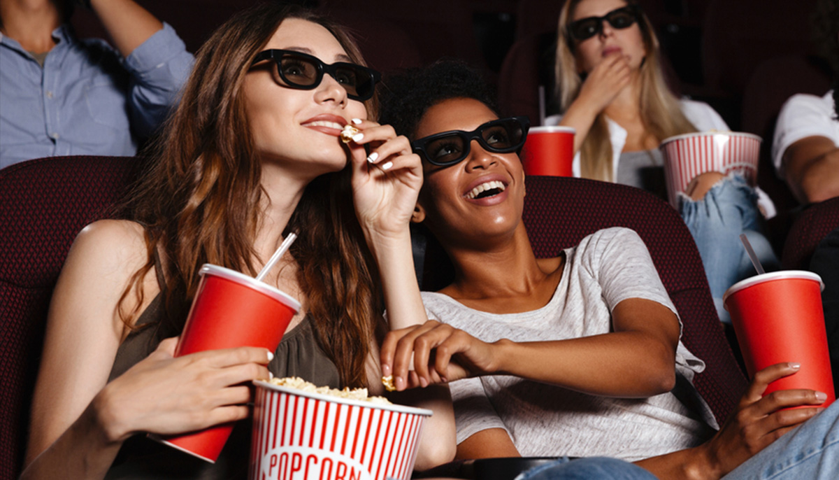 two-women-eat-popcorn-at-movies