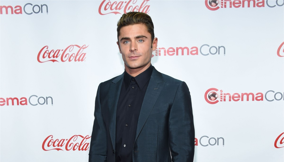 zac efron at a red carpet event wearing a dark suit