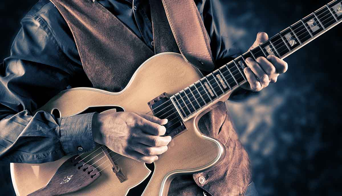 a vintage filtered image of a guitar player