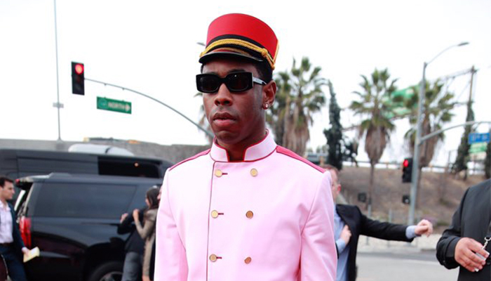 Tyler the Creator in a pink band uniform