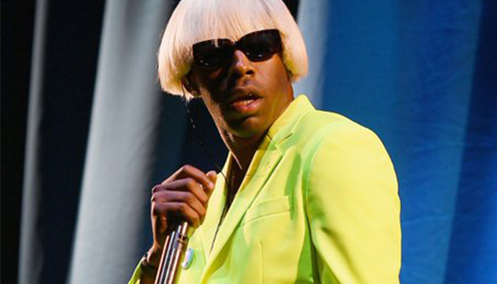 Tyler the Creator in a bright green suit