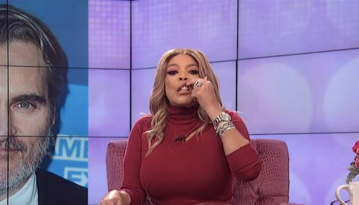 a still from the wendy williams show clipped to just show her lifting her lip to mock joaquin phoenixs lip