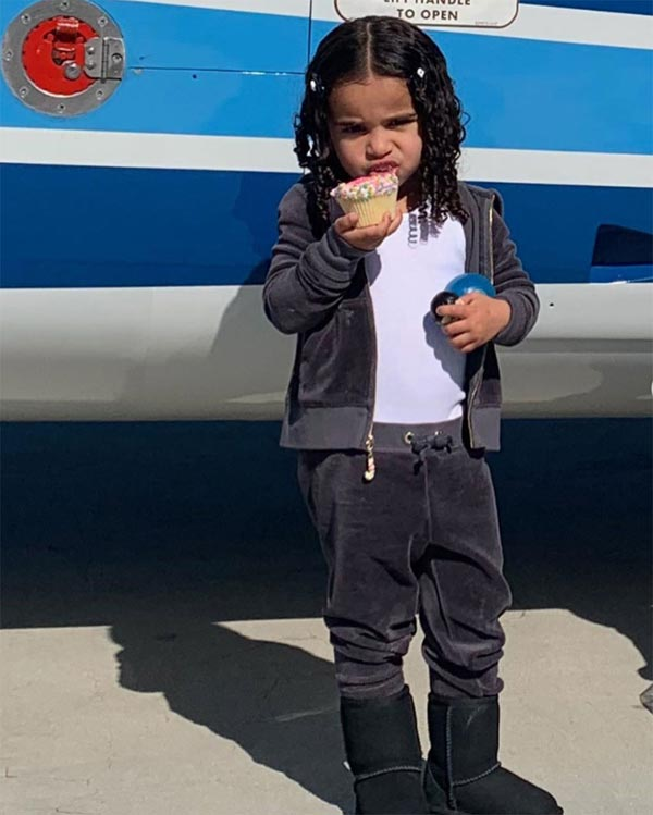 dream holding a cupcake in front of helicopter