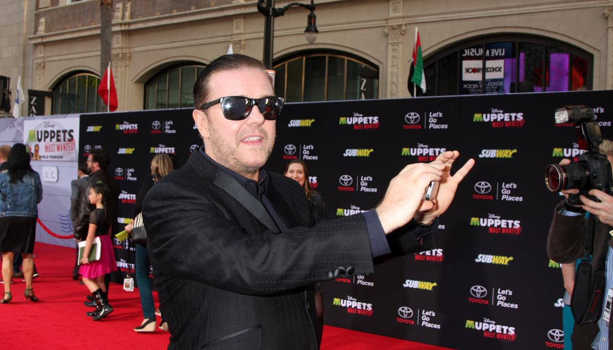 ricky gervais taking a selfie at a red carpet event