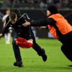 French Football Match Descends into Chaos as Pitch Invasion Leads to Brawl